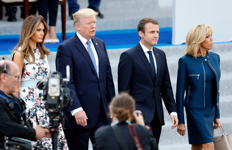 President Donald Trump and his wife, Melania Trump, with French President Emmanuel Macron and his wife, Brigitte Macron, at the traditional Bastille Day military parade on the Champs-Élysées on July 14, 2017, in Paris (Thierry Chesnot/Getty Images)