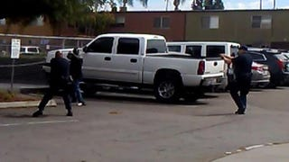 The police department in El Cajon, Calif., released this still from a witness's video, showing Alfred Olango before he was slain in a confrontation with officers. In protests that followed the shooting, people jumped a news cameraman, who said they stole a $15,000 camera, according to the San Diego Union-Tribune.Screenshot
