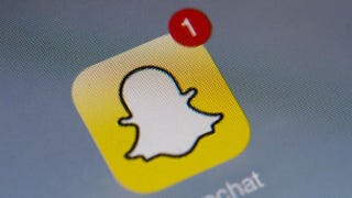 The logo of mobile app Snapchat is displayed on a tablet in Paris Jan. 2, 2014.LIONEL BONAVENTURE/AFP/Getty Images
