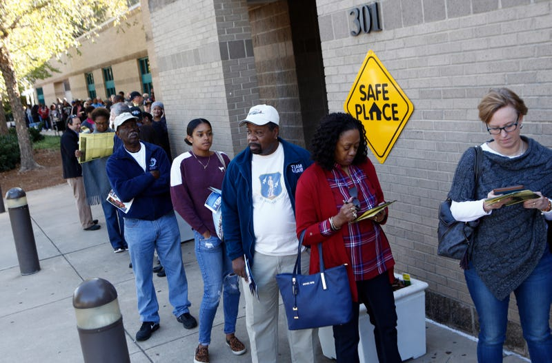 North Carolina residents wait in line to get into the Charlotte Mecklenburg University City Library to vote early Oct. 24, 2016, in Charlotte, N.C. Brian Blanco/Getty Images