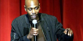 Dave Chappelle speaks to students in Washington, D.C., in 2006. (Joshua Roberts/Getty Images)