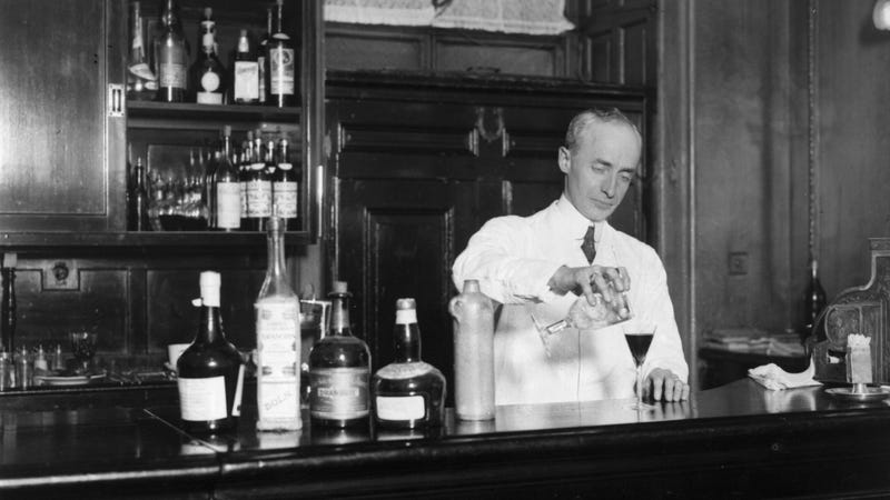 American barman Harry Craddock expertly mixes a drink in the American bar of the Savoy Hotel in London. Author of 'The Savoy Cocktail Book', Craddock invented such cocktails as the 'Dry Martini' and 'White Lady'. (Photo by Topical Press Agency/Getty Images)