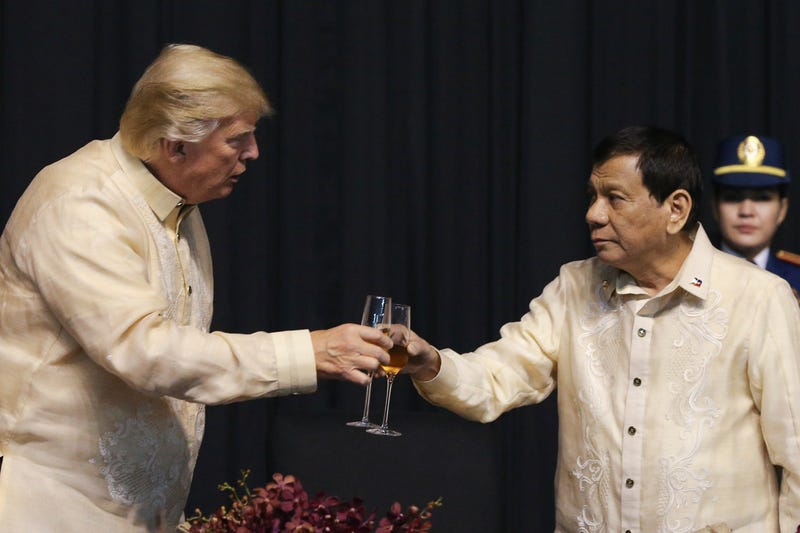 President Donald Trump toasts with Philippines President Rodrigo Duterte during the gala dinner marking ASEAN's 50th anniversary in Manila, Philippines, on Nov. 12, 2017. (Athit Perawongmetha-Pool via AP Images)