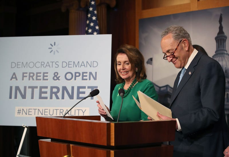Senate Majority Leader Charles Schumer (D-NY), with House Minority Leader Nancy Pelosi (D-CA) looking on, speaks at a press conference at the Capitol Building on May 16, 2018 in Washington, DC.
