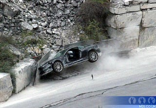 Illustration for article titled Daniel Craig Crashes Aston Martin DBS Into Quarry