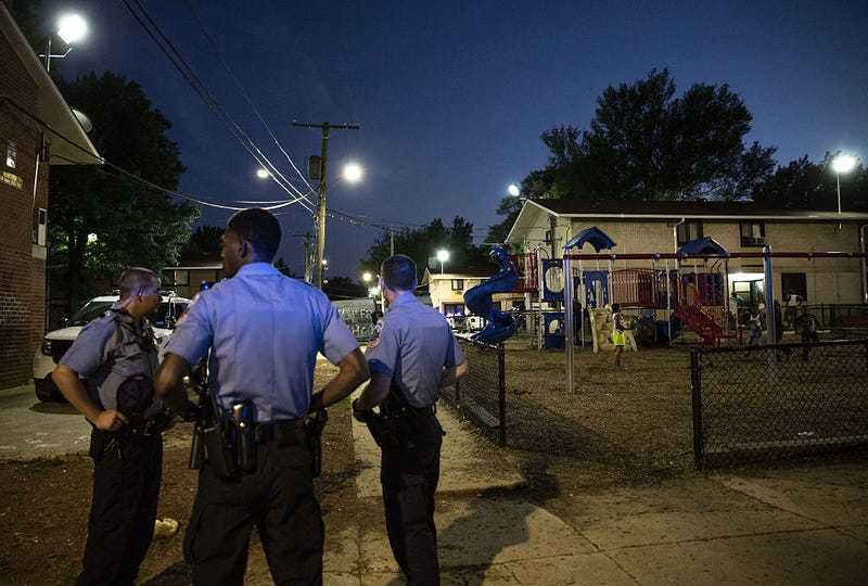 Police increased their presence at Woodland Terrace, a public housing complex in Southeast Washington, D.C., on July 31, 2015, after a spate of killings in the neighborhood.Evelyn Hockstein/For The Washington Post via Getty Images