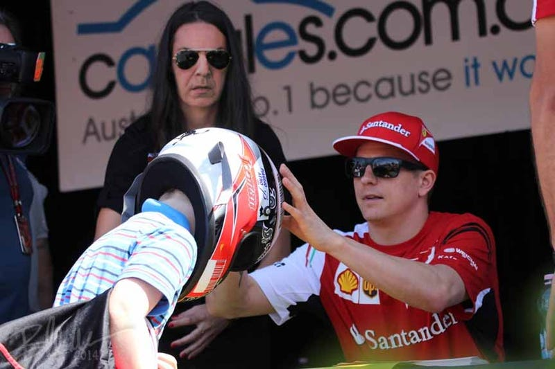 Illustration for article titled Kimi Signing Autographs In Austraulia With Professer Snape.