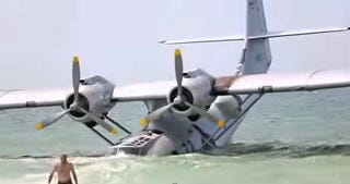 Illustration for article titled Vintage Catalina Flying Boat In Nic Cage Film Partially Sinks On Beach