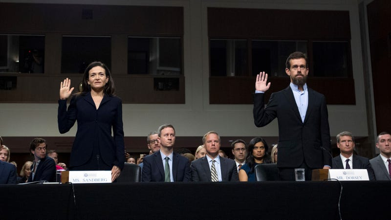 Facebook COO Sheryl Sandberg, left, accompanied by Twitter CEO Jack Dorsey are sworn in before the Senate Intelligence Committee hearing on 'Foreign Influence Operations and Their Use of Social Media Platforms' on Capitol Hill, Wednesday, Sept. 5, 2018, in Washington.