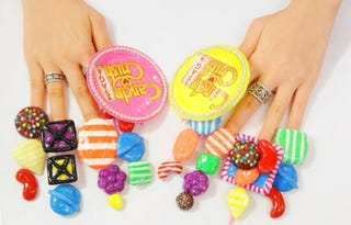 Illustration for article titled Woman Uses Her Unbelievable Fingernails To Promote Candy Crush