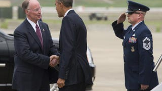 Ala. Gov. Robert Bentley and President Barack Obama shake hands upon Obama's arrival on Air Force One at Birmingham-Shuttlesworth International Airport in Birmingham, Ala., on March 26, 2015.SAUL LOEB/AFP/Getty Images