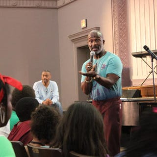 Famed gospel artist BeBe Winans addressing students attending the Children of the Gospel Choir Vocal Workshop at Deal Middle School in Washington, D.C.Washington Performing Arts.