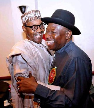Nigerian President Goodluck Jonathan (right) and presidential candidate of the ruling People's Democratic Party embraces leading opposition All Progressive Congress presidential candidate Mohammadu Buhari during a conference to promote nonviolence attended by party leaders in Abuja on Jan. 15, 2015.STR/AFP/Getty Images