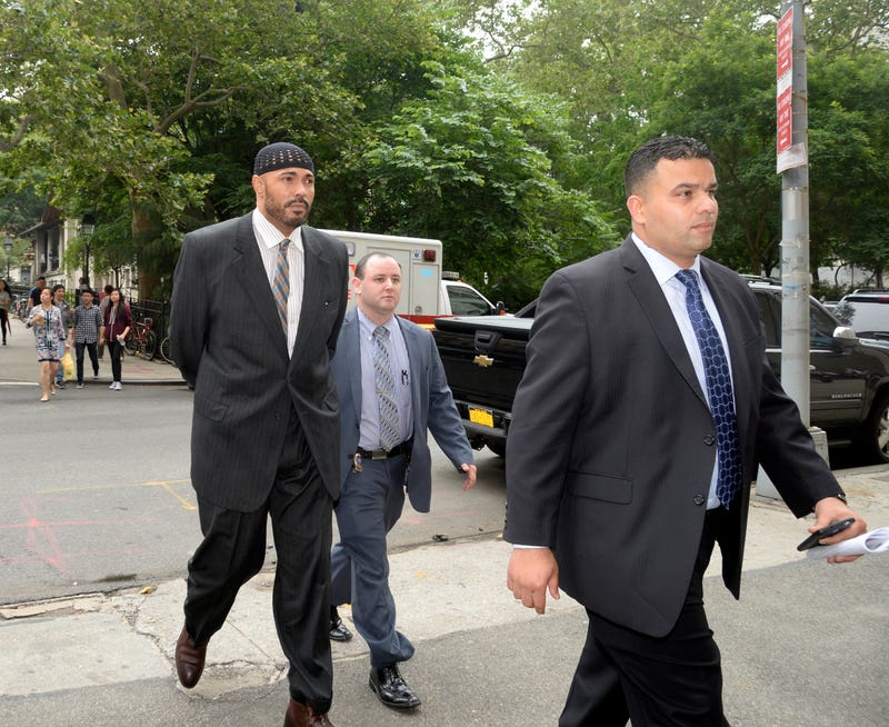 Bayna Lekheim El-Amin (left) is walked into Manhattan Central Booking in New York City on June 16, 2015. El-Amin was arrested for allegedly attacking a man at the Dallas BBQ restaurant in Chelsea.Jefferson Siegel/New York Daily News via Getty Images