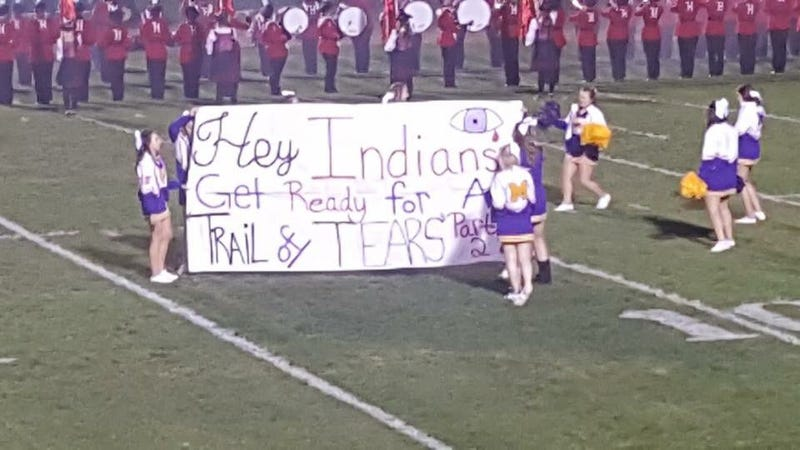 """Illustration for article titled Cheerleaders Display """"Trail Of Tears"""" Banner Before Game Against Team With Indian Mascot [Update]"""