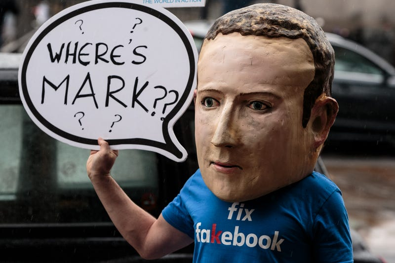 A protester wearing a model head of Facebook CEO Mark Zuckerberg poses for media outside Portcullis House on November 27, 2018 in London, England.