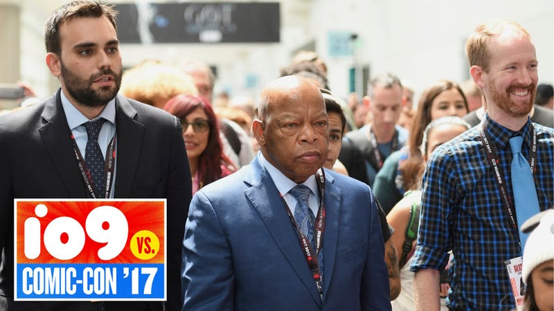 Rep. John Lewis (center) marches with March co-authors Andrew Aydin (left) and Nate Powell (right). All Photos by Al Powers/Invision/AP