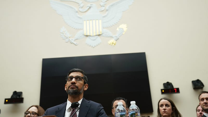 Google's Sundar Pichai testifying before Congress while his lobbyists throw $21.2 million at lawmakers.
