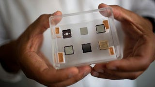 """Illustration for article titled Penny-sized """"microthrusters"""" could propel tiny satellites"""