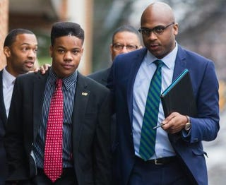 University of Virginia student Martese Johnson (left, foreground) and his lawyer, Daniel Watkins, March 26, 2015, in Charlottesville, Va.Zach Gibson/Getty Images