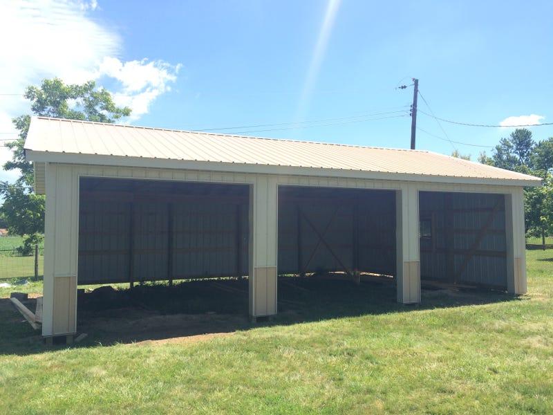 Needs: Concrete floor, garage doors, gravel drive, and insulation