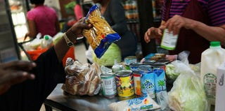 A client stocks up on goods at a New York food pantry. (Spencer Platt/Getty Images)