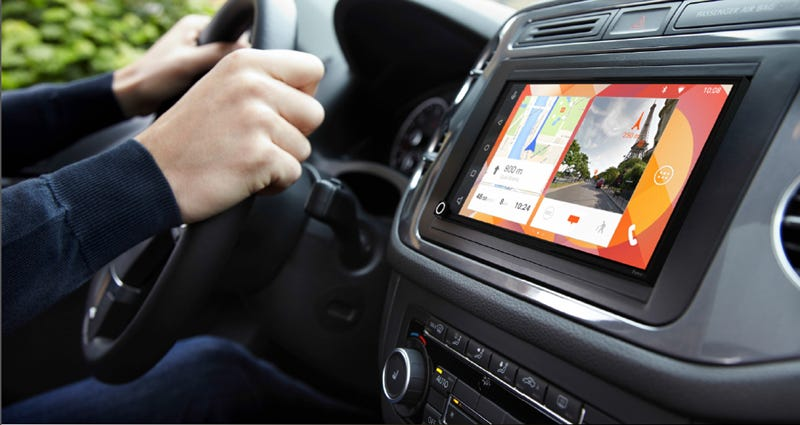 Illustration for article titled Parrot's New In-Dash System Gives Any Dumb Car Apple or Android Brains