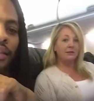 Waka Flocka Flame and an airline passengerYouTube screenshot