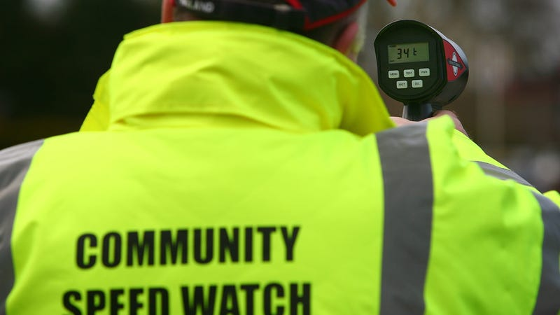 CREWE, UNITED KINGDOM - APRIL 01: Volunteers from the Community Speed Watch track and record the speed of drivers through the village of Church Minshull on April 1, 2008, in Crewe, England. The volunteers operate under the direction of the local police authority and is designed to help the police by making drivers aware of their speed. Community Speed watch does not enforce the law, but those identified as exceeding the limit receive an advisory letter from the Police.