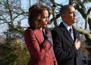 President Barack Obama and first lady Michelle Obama take part in a wreath-laying ceremony in honor of President John F. Kennedy at Arlington National Cemetery on Nov. 20, 2013, in Virginia.MANDEL NGAN/AFP/Getty Images
