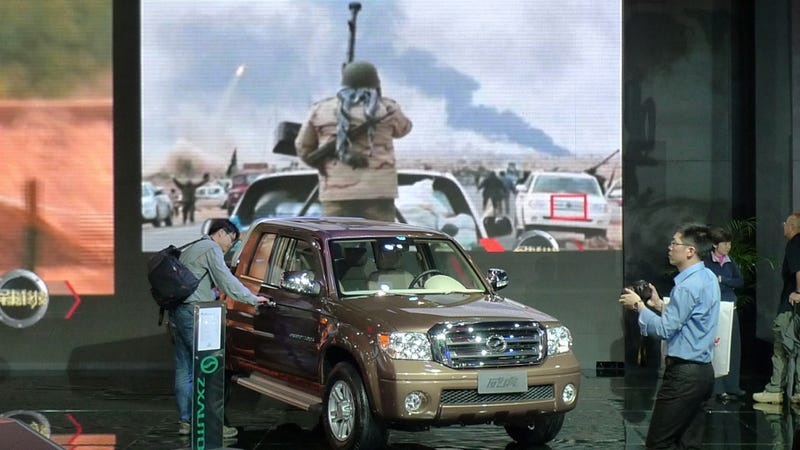 Illustration for article titled Chinese Use Libyan Uprising To Advertise 'Stronger Than War' Trucks