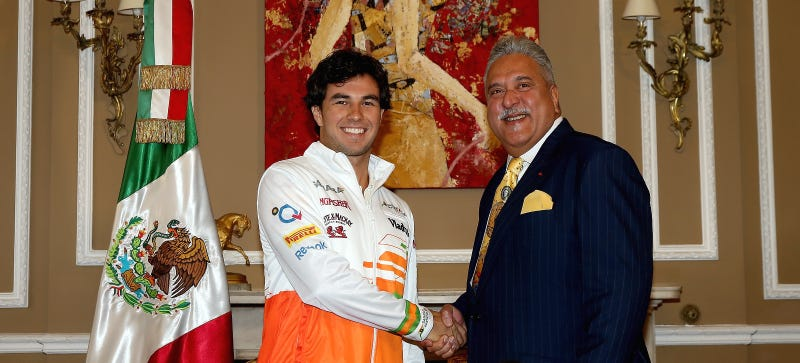 Vijay Mallya (left) shaking hands with Force India driver Sergio Perez. Photo credit: Getty Images