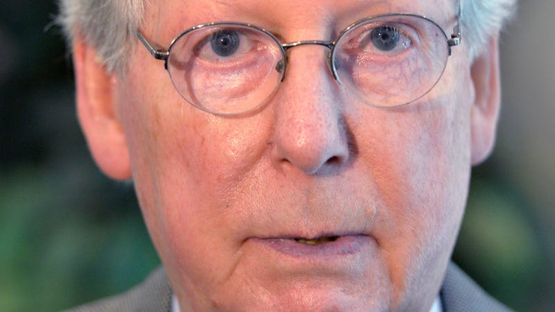 Kentucky Sen. Mitch McConnell speaks with reporters following his speech to the monthly meeting of the Rotary Club, Tuesday, May 26, 2015, in Elizabethtown Ky.