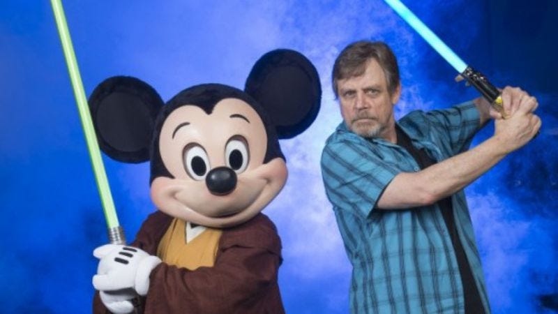 Illustration for article titled Mark Hamill poses next to cartoon mouse as he meets his Star Wars destiny
