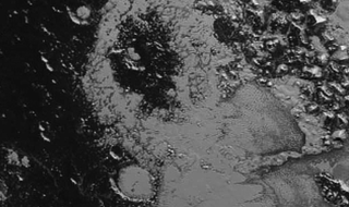 Illustration for article titled Newly-Discovered Mountains on Pluto Finally Have Those Missing Craters
