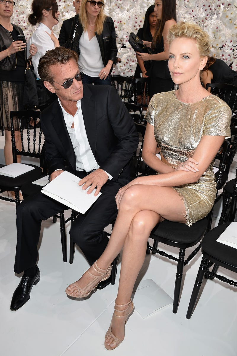 Illustration for article titled Here Is a Photo of Sean Penn and Charlize Theron in Need of a Caption
