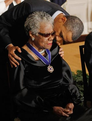 President Barack Obama kisses Maya Angelou after giving her the 2010 Medal of Freedom in the East Room of the White House Feb. 15, 2011.Chip Somodevilla/Getty Images