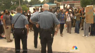 Several people gather to protest the shooting of unarmed teen Michael Brown, who was fatally shot by police in Ferguson, Mo., Aug. 9, 2014.NBC 4 screenshot