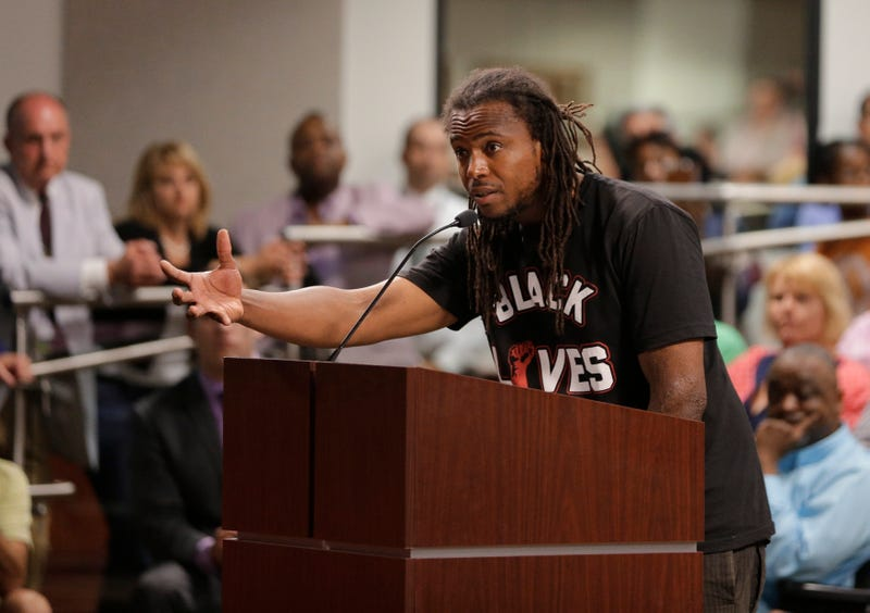 Muhiyidin D'Baha speaks during a meeting with North Charleston, S.C., City Council on April 9, 2015, about the killing of Walter Scott by a North Charleston police officer. (Chuck Burton/AP Images)