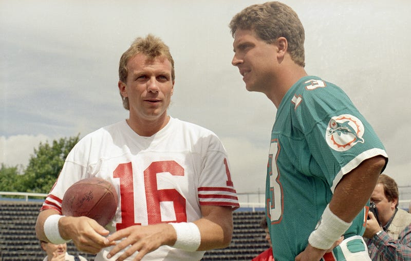 Joe Montana and Dan Marino were two of the biggest NFL stars in 1990. Marino ultimately signed over his marketing rights to the NFL, while Montana refused, but not out of solidarity with the NFLPA: he wanted a bigger cut than everybody else. (Photo credit: Doug Jennings/AP)