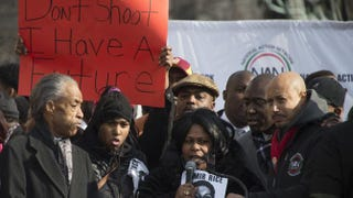 Samaria Rice, center, mother of 12-year-old Tamir Rice, who was fatally shot Nov. 22 by a Cleveland police officer, speaks during the Justice for All rally in Washington, D.C., Dec. 13, 2014.Jim Watson/AFP/Getty Images