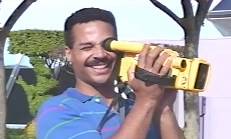 "Man holding a video camera in the 1991 promotional video ""A Day at Epcot Center"""