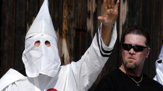 A Ku Klux Klan member salutes during an American Nazi Party rally at Valley Forge National Park in Valley Forge, Pa., on Sept. 25, 2004. William Thomas Cain/Getty Images