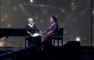 Maya Angelou and Oprah Winfrey during the taping of the second-to-last episode of TheOprah Winfrey Show at the United Center in Chicago May 17, 2011.PETER WYNN THOMPSON/AFP/Getty Images