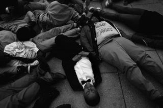 "Schoolchildren from the Potomac Preparatory Charter School take part in a die-in during a protest outside the Office of Police Complaints as part of a planned ""28 Hours for Mike Brown"" protest Nov. 25, 2014, in Washington, D.C.Win McNamee/Getty Images"