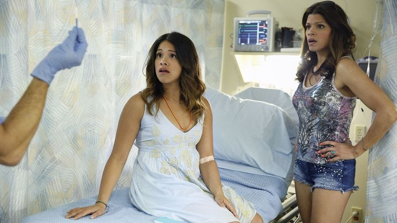 Gina Rodriguez (center) and Andrea Navedo in Jane The Virgin