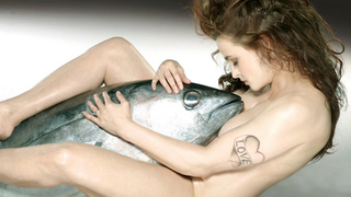 Illustration for article titled Naked Helena Bonham Carter Cuddles a Giant Dead Tuna Because Why Not