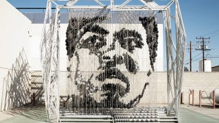 Illustration for article titled This Amazing Sculpture of Muhammad Ali Was Made with Punching Bags