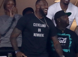 "LeBron James wearing the ""Cleveland or Nowhere"" T-shirtTwitter"