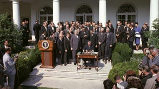 President Lyndon Johnson signs the Economic Opportunity Act on May 21, 1964.LBJ Library, photo by Cecil Stoughton